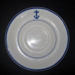 Recuperan plato de porcelana del USS Salute hundido en 1943